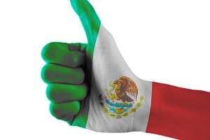 Mexico flag painted hand showing thumbs up sign on isolated white background with clipping path