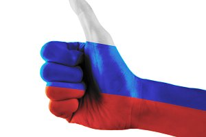 Russian Federation flag painted hand showing thumbs up sign on isolated white background with clipping path