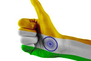 India flag painted hand showing thumbs up sign on isolated white background with clipping path