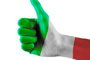 Italy flag painted hand showing thumbs up sign on isolated white background with clipping path