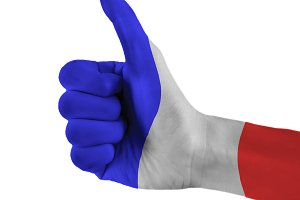 France flag painted hand showing thumbs up sign on isolated white background with clipping path