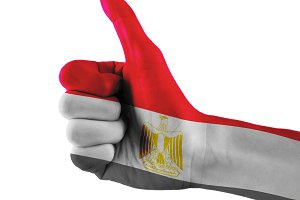 Egypt flag painted hand showing thumbs up sign on isolated white background with clipping path