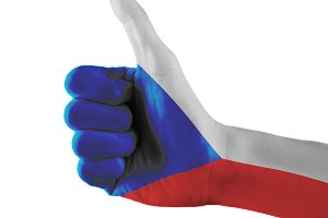 Czech Republic flag painted hand showing thumbs up sign on isolated white background with clipping path