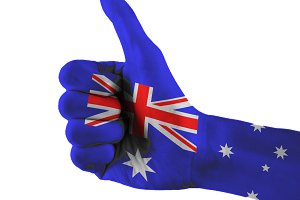 Australia flag painted hand showing thumbs up sign on isolated white background with clipping path