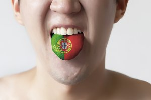 Portugal flag painted in tongue of a man - indicating Portuguese language and speaking