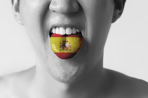 Spain flag painted in tongue of a man - indicating Spanish language and speaking n Black and White