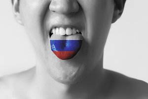 Russia Federation flag painted in tongue of a man - indicating Russian language and speaking - black and white