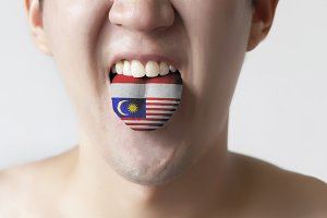 """Malaysia and Indonesia flag painted in tongue of a man - indicating """" Bahasa """" language and speaking"""