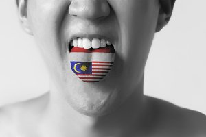 """Malaysia and Indonesia flag painted in tongue of a man - indicating """" Bahasa """" language and speaking - Black and white"""