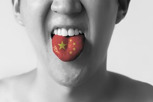 China flag painted in tongue of a man - indicating Chinese language and speaking in Black and White tone