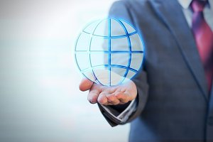 Businessman holding a virtual networking globe on palm of his hand