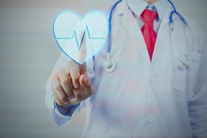 Doctor with stethoscope press down blue heart on virtual screen