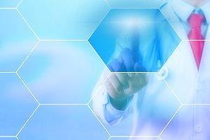 Doctor touching on virtual hexagonal screen with copyspace