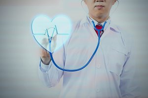 Doctor using stethoscope to press down virtual heart