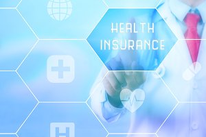 Doctor touching 'Health Insurance' on virtual screen
