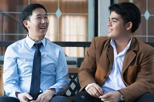 Two Asian Business Men Discussing while Sitting