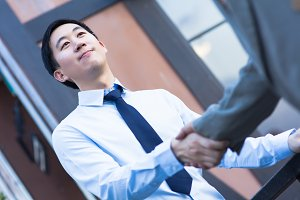Asian Business Man Shake Hands with Another Business Man