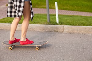 woman is standing on a skate