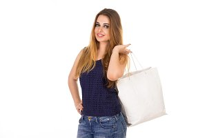 Smiling woman with white handbag