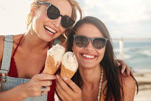 Two young friends having ice cream
