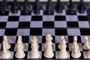 Chess pieces lining up against each other on Chess board