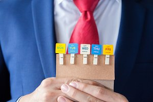 Businessman holding happy working days cards