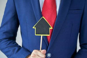 Businessman offering house / real estate deal opportunities