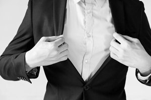 Modern businessman adjusting his suit for work preparation