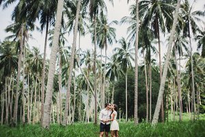 young couple posing in park