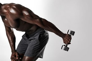African man doing dumbbell exercise