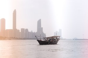 skyline with old fishing boat