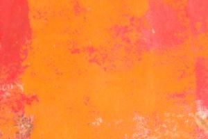 Defocused orange painted surface