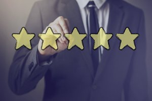 Businessman drawing five stars in the air