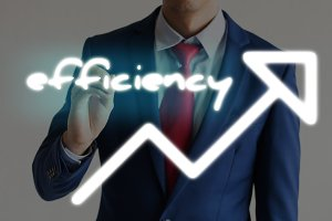 Businessman drawing EFFICIENCY and upward graph arrows forward