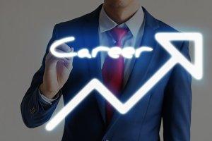 Businessman drawing Career and upward graph arrows forward