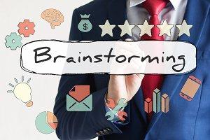 Brainstorming drawn on virtual board by businessman