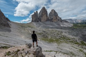 Hiker hiking in Dolomites mountains