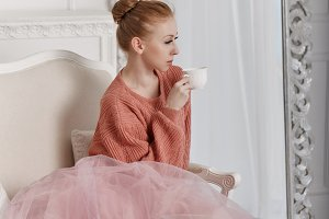 Ballerina drink coffee