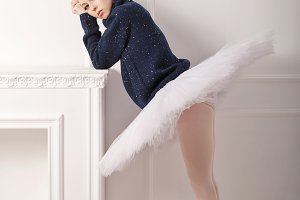 Ballerina grieves fireplace