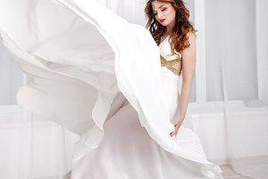 Girl in a white long dress.