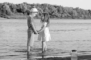 boy and girl on the river