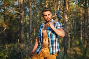 Lumberjack with an ax posing.