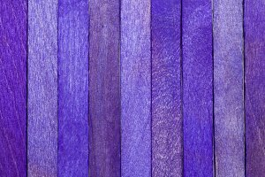 Rough wood texture painted in purple for background