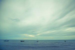 Small boat in tropical ocean