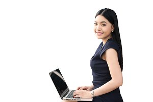 Asian woman sitting and playing a laptop on white isolated background