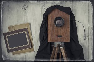 Old studio camera and old photos