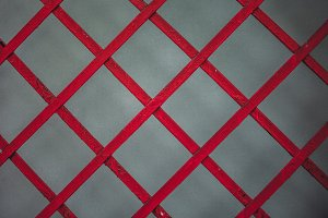 Red wood grid on grey background