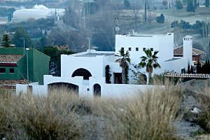 fog and white andalusian house