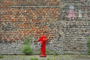 Fire tap and red brick wall