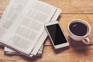 smartphone with newspaper